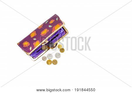 Coins and an open purse on a white background.