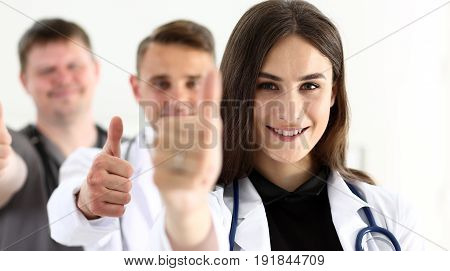 Group Of Doctor Show Ok Or Approval Sign With Thumb Up