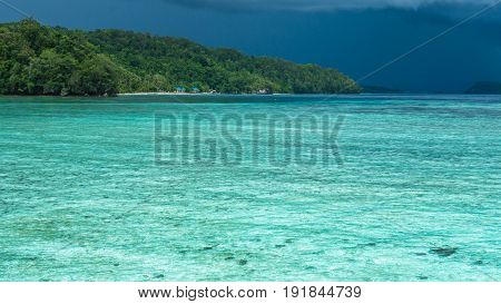 Beautiful Blue Lagoone shortly before Thunderstorm, near Kordiris Homestay, Gam Island, West Papuan, Raja Ampat, Indonesia.