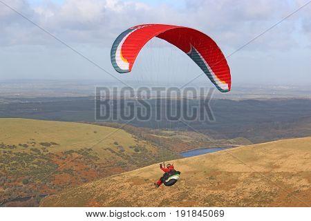 Paraglider flying wing above Dartmoor in Devon