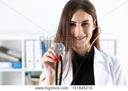 Beautiful Smiling Female Doctor Hold In Hand Stethoscope Head