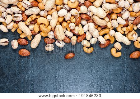 Healthy Mix Nuts On Dark Background. Almonds, Pistachio, Cashews