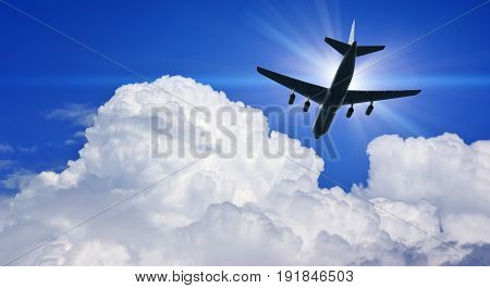 Airplane silhouette in deep blue sky. Airplane travel composition