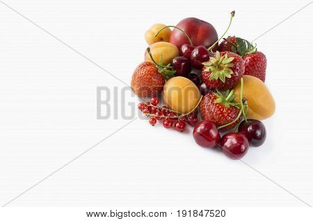 Ripe strawberries red currants apricots and cherries isolated on white background. Berries with copy space for text. Background berries. Various fresh summer berries on white background.