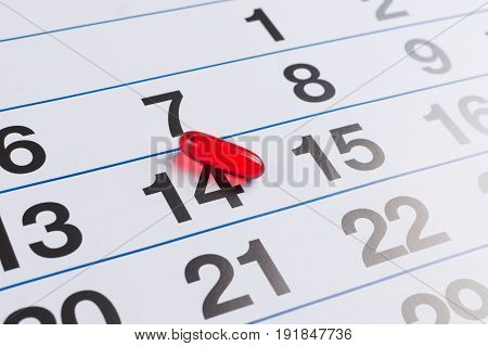 Red Pill On The Calendar. Schedule Medication