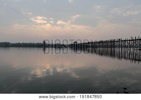 U-BEIN BRIDGE/AMARAPURA, MYANMAR JAN 22: U-Bein bridge the worlds longest foot bridge spanning 1300 yardy/1,2 km over Taungthaman lake at dusk January 22, 2016, U-Bein bridge/Amarapura near Mandalay.