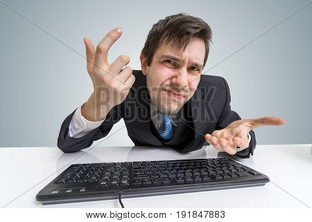 Confused Frustrated Man Is Working With Computer.