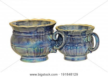 Two blue retro style ceramic tea cups isolated on white background.