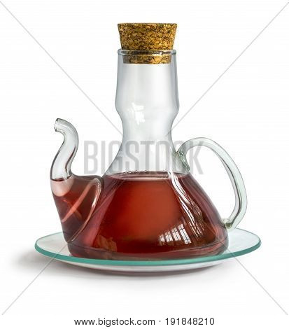 Decanter with wine vinegar isolated on the white background with clipping path