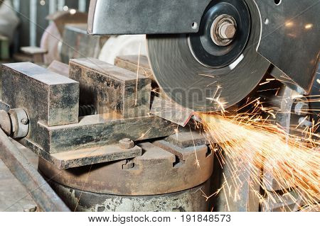 Circular cutting disc cuts off part of the metal corner, close-up