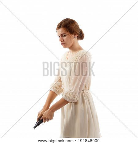 A young lady in a dress reloading a handgun