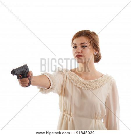 A young lady in a white dress pointing a handgun