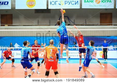 MOSCOW - APR 8, 2017: Jumping player at match of Russian Volleyball Championship Dynamo (Moscow) - Nova (Novokuibyshevsk) in Palace of Sports Dynamo