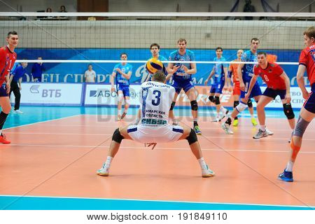 MOSCOW - APR 8, 2017: Libero takes delivery of opponent at match of Russian Volleyball Championship Dynamo (Moscow) - Nova (Novokuibyshevsk) in Palace of Sports Dynamo