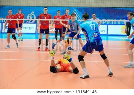 MOSCOW - APR 8, 2017: Libero saves ball, does dig at match of Russian Volleyball Championship Dynamo (Moscow) - Nova (Novokuibyshevsk) in Palace of Sports Dynamo