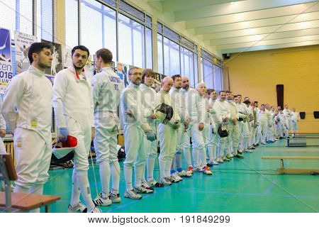MOSCOW - APR 22, 2017: Participants in sport uniform at Spring Fencing Tournament in club En Garde, En Garde club was founded in 1997 in Department of Fencing of University of Physical Culture, Sports