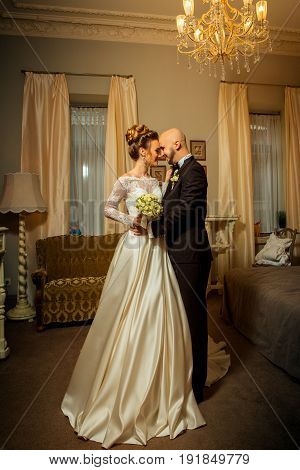 vertical portait of beautiful young just married couple