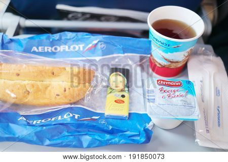 MOSCOW - MAR 4, 2017: Breakfast in Aeroflot airplane during flight, Aeroflot is largest airline in Russia