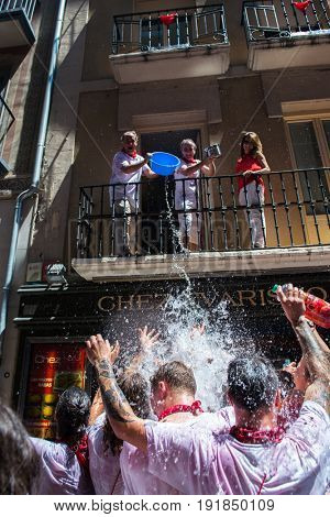 People celebrate San Fermin festival in traditional white abd red clothing with red necktie, 06 July 2016, Pamplona, Navarra, Spain.