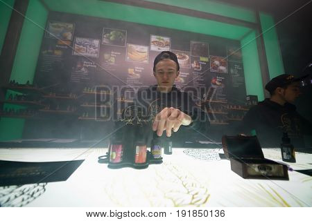 MOSCOW - DEC 10, 2016: E-cigarettes bar at Vapexpo MOSCOW - international exhibition and conference of VAPE-industry in Sokolniki Exhibition Center