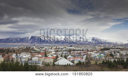 Iceland's capital Reykjavik with volcanoes in the background.