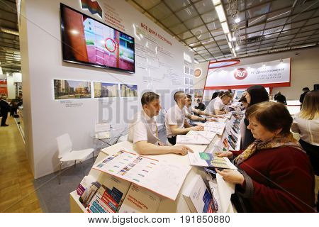 MOSCOW - MAR 16, 2017: Visitors at real estate exhibition in Central House of Artists, 200 companies took part in exhibition
