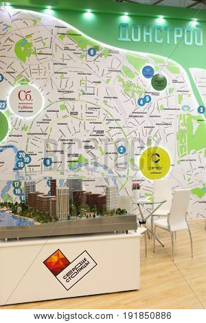MOSCOW - MAR 16, 2017: Stand of Donstroy company with map at real estate exhibition in Central House of Artists, 200 companies took part in exhibition