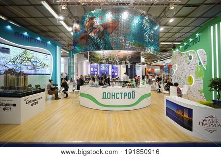MOSCOW - MAR 16, 2017: Stand of Donstroy company at real estate exhibition in Central House of Artists, 200 companies took part in exhibition