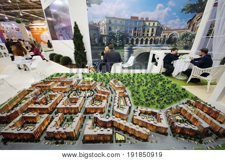 MOSCOW - MAR 16, 2017: Miniature of buildings and people at real estate exhibition in Central House of Artists, 200 companies took part in exhibition