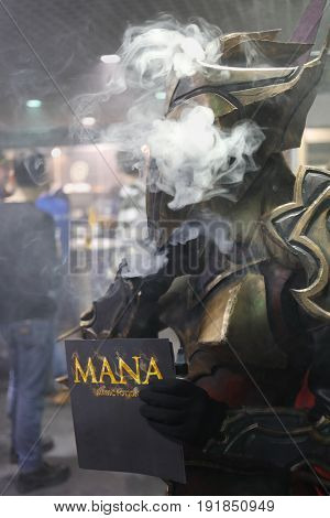 MOSCOW - DEC 10, 2016: Man in vape robot costume at Vapexpo MOSCOW - international exhibition and conference of VAPE-industry in Sokolniki Exhibition Center