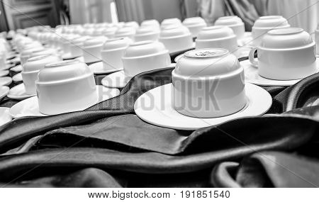 several coffee cups on a coffee break table