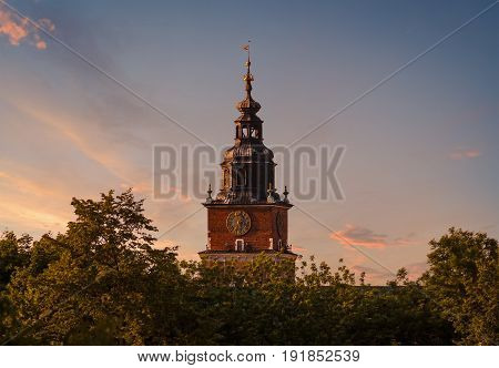 Town hall tower on the background of dramatic sky. Krakow. Poland