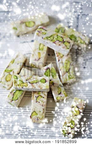 Soft cubes of white nougat with pistachios