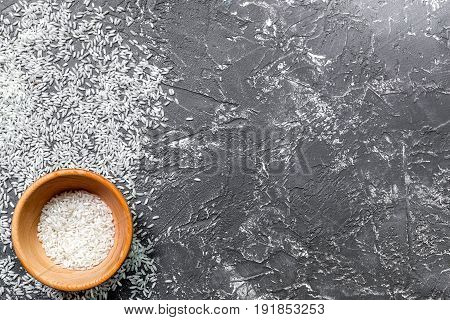 rice, spices for paella on dark kitchen desk background top view