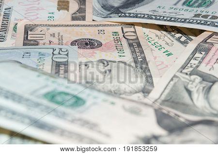 Background of scattered ten and twenty dollar bills close-up