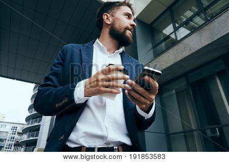 Businessman with telephone, businessman looking away, businessman with coffee mug.