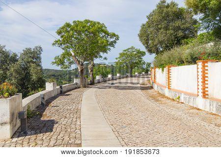 Street To Igreja Matriz Church And Castle In Santiago Do Cacem
