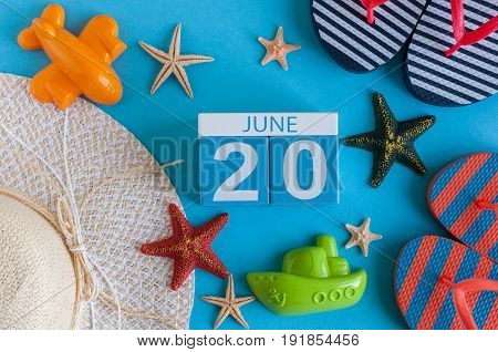 June 20th. Image of june 20 calendar on blue background with summer beach, traveler outfit and accessories. Summer day.