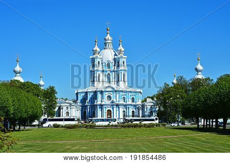 The building of the Smolny Cathedral in Saint-Petersburg against the blue sky on a bright Sunny day.