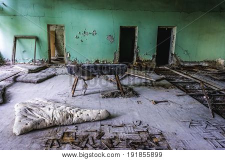 Gym in abandoned school in Pripyat city in Chernobyl Exclusion Zone Ukraine