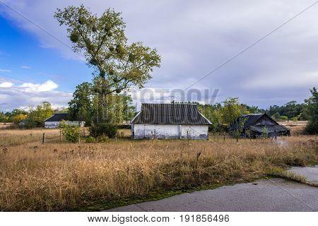 Wooden cottage in Kupuvate village in Chernobyl Exclusion Zone Ukraine