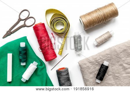 Sewing tools and kit for handmade hobby collection on white background top view pattern