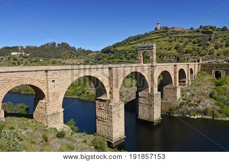 Roman Bridge Over The Tajo River In Alcantara, Caceres Province, Extremadura, Spain
