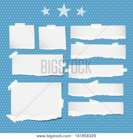 White ripped notebook, copybook sheets, stars stuck with sticky tape on blue dotted pattern