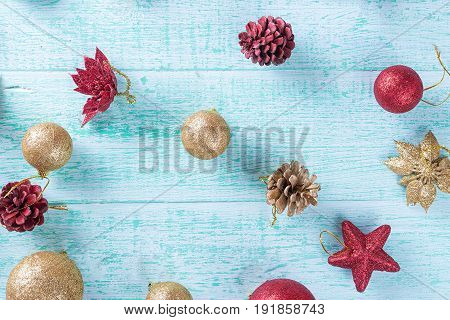 Christmas toys on the Christmas tree on a blue wooden background