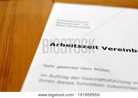 A letter on a wooden table - working hours
