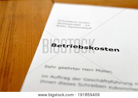 A letter on a wooden table - overhead