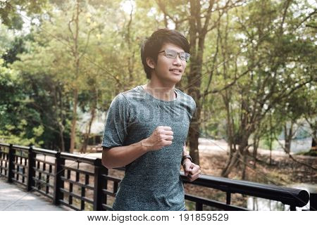 Runner Man. Health And Fitness Outdoor Concept. Man Is Jogging In The Morning. Young Man Doing Sport