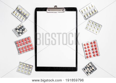 Modern medicine workplace with board, stethoscope on white table background flat lay space for text
