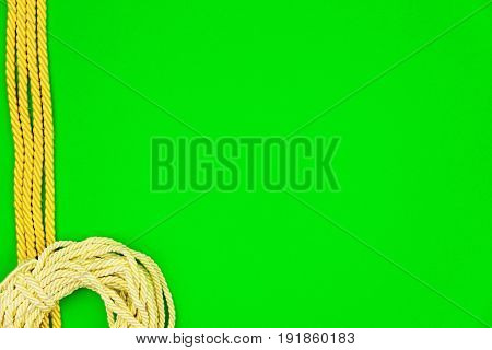 Yellow string and three cords isolated on green background